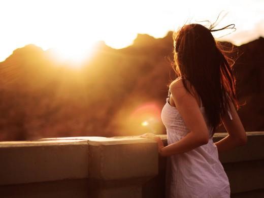 woman-watching-sunset-1600x1200