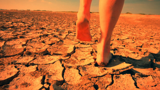 barefoot-woman-walks-through-surreal-desert-land-landscape-autistic-depressed-and-emotional-scene-of-human-psychological-problems_n3eu_blbug__F0005